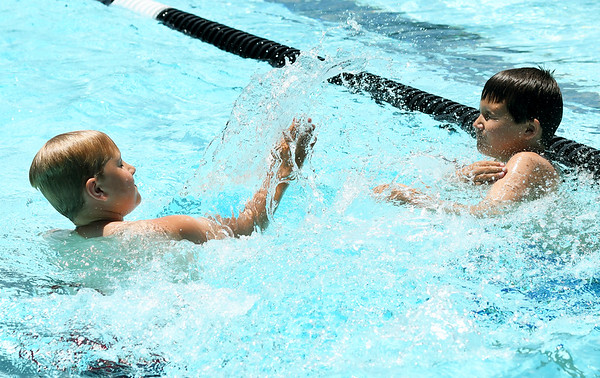 From the left: Burke Diskin, 8 and Jordan Vann, 9, enjoy a splash fight during Missouri Southern's Children's Lifetime Sports Academy on Thursday at the Millenium Tennis and Fitness Center pool. The program, sponsored by MSSU's Department of Kinesiology, features activities that include bowling, archery, fishing, canoeing and dance.<br /> Globe   Laurie Sisk