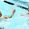 From the left: Burke Diskin, 8 and Jordan Vann, 9, enjoy a splash fight during Missouri Southern's Children's Lifetime Sports Academy on Thursday at the Millenium Tennis and Fitness Center pool. The program, sponsored by MSSU's Department of Kinesiology, features activities that include bowling, archery, fishing, canoeing and dance.<br /> Globe | Laurie Sisk