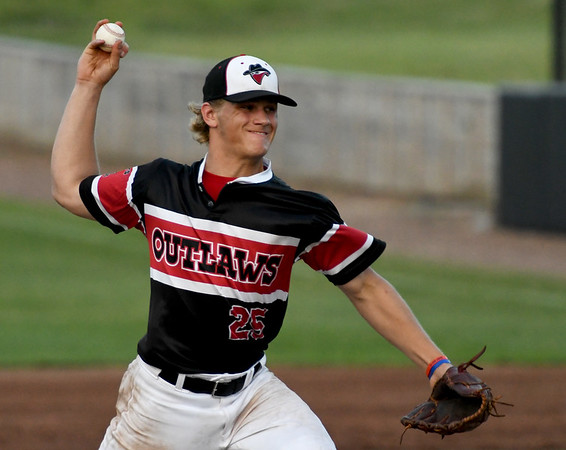 Outlaws reliever Hunter Wienhoff throws from the mound during Joplin's game against St. Joseph on Wednesday night at Joe Becker Stadium.<br /> Globe | Laurie Sisk