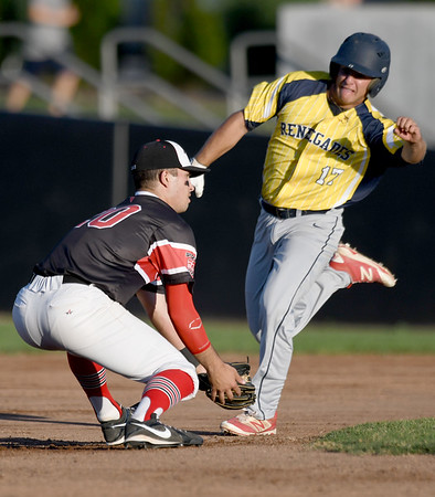 Jefferson City's Hunter Swift eyes second base as Joplin's Kaleb De La Torre fields the throw during their game on Tuesday night at Joe Becker Stadium.<br /> Globe | Laurie Sisk