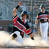Joplin's Kaleb Delatorre slides home safely as teammate Calem Nutting looks on during their game against Cassville  on Tuesday night at Joe Becker Stadium.<br /> Globe | Laurie Sisk