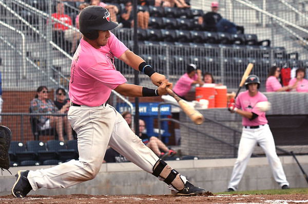 Joplin's Matt Delavega swings at a pitch during the Outlaws game against Chillicothe on Saturday night at Joe Becker Stadium.<br /> Globe | Laurie Sisk