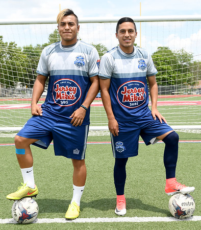 From the left: Joplin High School athletes Dominique Salcedo and Luis Santillan pose for a photo dressed in their Demize uniforms on Tuesday at Junge Stadium.<br /> Globe | Laurie Sisk