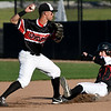 Arrows catcher Marcus Crawford, of Neosho,  is forced out on the front half of a double play as Joplin's Kaleb Delatorre throws to first during their game on Tuesday night at Joe Becker Stadium.<br /> Globe | Laurie Sisk