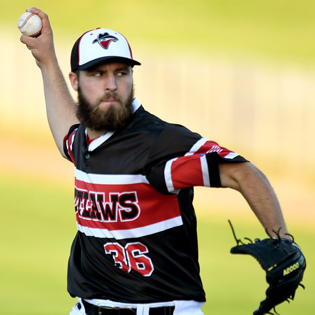 Outlaws starter Hunter Huckabee throws from the mound during the Outlaws' game against Jefferson City on Tuesday night at Joe Becker Stadium.<br /> Globe | Laurie Sisk
