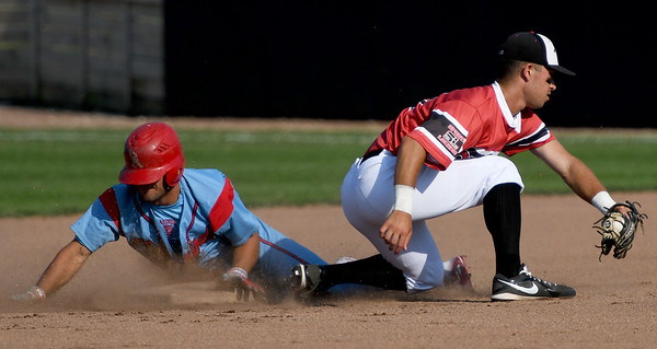 Clarinda's Mojo Hage slides safely into second base as Joplin's Kaleb Delatorre fields the throw during the first game of a doubleheader on Thursday night at Joe Becker Stadium.<br /> Globe   Laurie Sisk