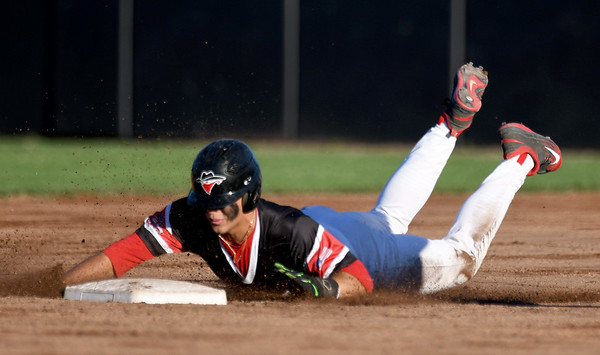Joplin's Kaden Fowler slides safely into second base during the Outlaws' game against Jefferson City on Tuesday night at Joe Becker Stadium.<br /> Globe | Laurie Sisk