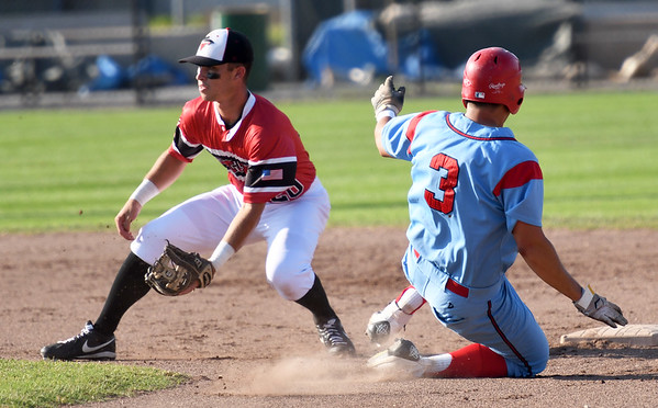 Clarinda's Mondesi Gutierrez slides safely into second base as Joplin's Kaleb Delatorre awaits the throw during the first game of a doubleheader on Thursday night at Joe Becker Stadium.<br /> Globe | Laurie Sisk