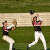 Joplin's Dalton Weaver, right,  closes in on a fly ball as teammate Zack Ehlen backs up the play during the Outlaws game against Sedalia on Wednesday night at Joe Becker Stadium.<br /> Globe | Laurie Sisk