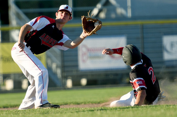 Joplin's Zack Ehlen slides safely into second base as Arrows shortstop Kemper Smith fields the throw during their game on Tuesday night at Joe Becker Stadium.<br /> Globe | Laurie Sisk