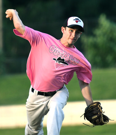 Joplin starter Christian Lilly throws from the mound during the Outlaws game against Chillicothe on Saturday night at Joe Becker Stadium.<br /> Globe | Laurie Sisk