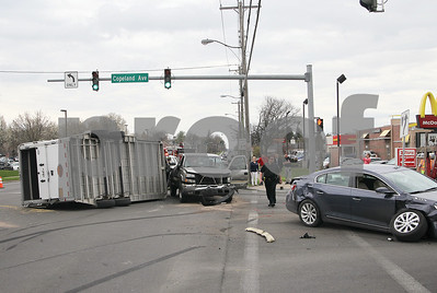 Spencer Tulis / Finger Lakes Times A crash involving a car and a pickup truck  towing a horse trailer carrying racing Thoroughbreds, collided Friday afternoon on Hamilton Street in Geneva.