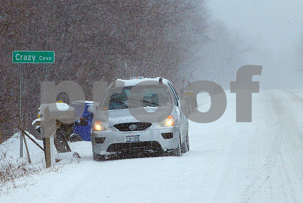 Spencer Tulis/Finger Lakes Times Through sleet, hail or snow the U.S. Postal Service made sure all got their mail Tuesday as shown by this deliverer on Route 14 in the town of Geneva.