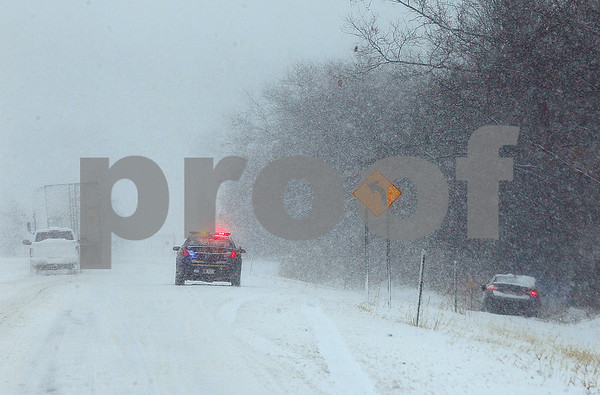 Spencer Tulis/Finger Lakes Times Slick roads were the reason this vehicle ended up off Route 5 & 20 in Waterloo Tuesday.