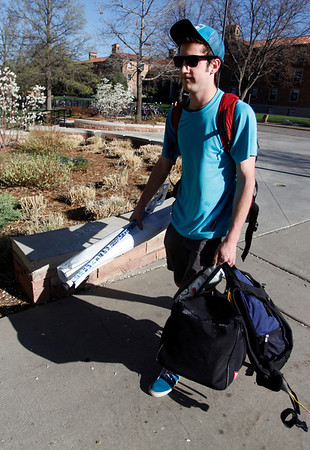 "Michael Moran returns from Denver after spending spring break with his family on Sunday, April 1, 2012. Boulder. <br />  For more photos of the game visit  <a href=""http://www.dailycamera.com"">http://www.dailycamera.com</a><br /> Photo by Derek Broussard"