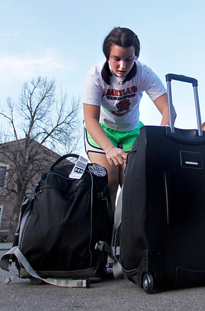 "Lindsay Carver unpacks her luggage after spending spring break in D.C. April 1, 2012. Boulder. <br />  For more photos of the game visit  <a href=""http://www.dailycamera.com"">http://www.dailycamera.com</a><br /> Photo by Derek Broussard"