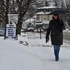 KRISTOPHER RADDER - BRATTLEBORO REFORMER<br /> Deb Hicks, of Vernon, walks down Main Street while it was sleeting on Monday, April 16, 2018.