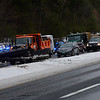 KRISTOPHER RADDER - BRATTLEBORO REFORMER<br /> Cars lined up on I-91 North near exit 6 while workers remove a truck that was jacked-knifed. The highway was closed for about an hour.