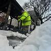 KRISTOPHER RADDER - BRATTLEBORO REFORMER<br /> Doug Morse, the building maintenance worker for the town of Brattleboro, shovels the sideways of Pliny Park nMonday, April 16, 2018.