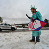 KRISTOPHER RADDER - BRATTLEBORO REFORMER<br /> Alex Farley braves the weather while dressed as the Liberty Tax mascot on Monday, April 16, 2018.