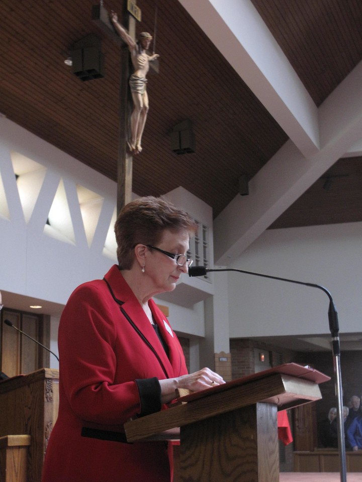 ELIZABETH DOBBINS / GAZETTE Parishioner Linda Chesnik reads a passage from the book of Isaiah.