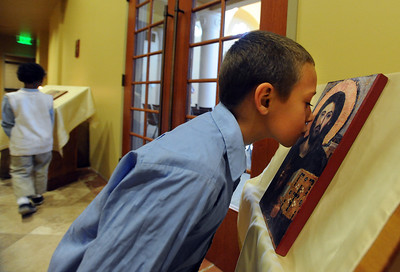 Donovan Boyd kisses an icon at the St. Luke Orthodox Christian Church in Erie. For more photos of the church, go to www.dailycamera.com. Cliff Grassmick / September 5, 2010
