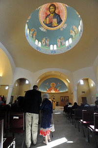 Usher Peter Mustian helps a woman to her seat before the Sunday service of the St. Luke Orthodox Christian Church. For more photos of the church, go to www.dailycamera.com. Cliff Grassmick / September 5, 2010