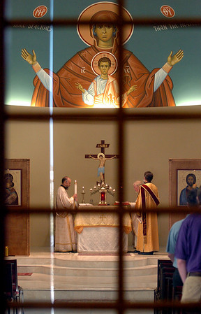 "Sunday morning service at the St. Luke Orthodox Christian Church, lead by Rev. Fr. David Mustian, right.<br /> For more photos of the church, go to  <a href=""http://www.dailycamera.com"">http://www.dailycamera.com</a>.<br /> Cliff Grassmick / September 5, 2010"