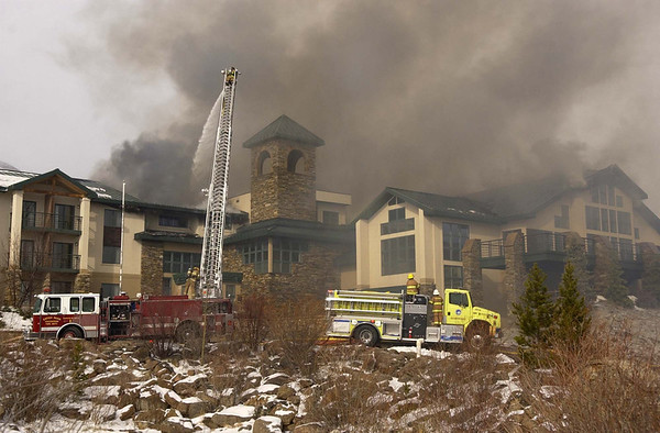 20111114_MALO_FIRE_05.JPG Firefighters from multiple agencies battle a fire at the main lodge of the St. Malo Retreat Center, 10758 Highway 7, near Allenspark on Monday, Nov. 14, 2011. (Richard M. Hackett/Times-Call)