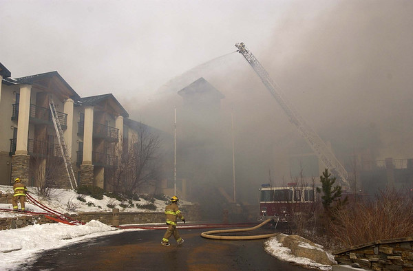 20111114_MALO_FIRE_02.JPG Firefighters from multiple agencies battle a fire at the main lodge of the St. Malo Retreat Center, 10758 Highway 7, near Allenspark on Monday, Nov. 14, 2011. (Richard M. Hackett/Times-Call)