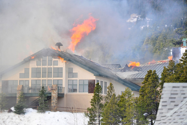 16EP News St. Malo Fire.jpg Walt Hester | Trail Gazette<br /> Flame erupt from the main lodge building on Monday at the St. Malo Retreat Center south of Estes Park. Firefighters from Estes Park, Allenspark and Big Elk Meadows rushed to the fire on Monday morning.