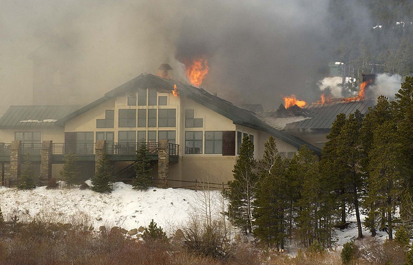20111114_MALO_FIRE_04.JPG Flames erupt from the roof as firefighters from multiple agencies battle a fire at the main lodge of the St. Malo Retreat Center, 10758 Highway 7, near Allenspark on Monday, Nov. 14, 2011. (Richard M. Hackett/Times-Call)