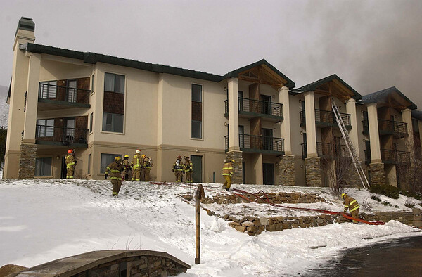 20111114_MALO_FIRE_06.JPG Firefighters from multiple agencies battle a fire at the main lodge of the St. Malo Retreat Center, 10758 Highway 7, near Allenspark on Monday, Nov. 14, 2011. (Richard M. Hackett/Times-Call)