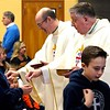 BEN GARVER — THE BERKSHIRE EAGLE<br /> Father Brian McGrath and Bishop Mitchel Rozanski give eucharist to students at St. Mary's School in Lee as they celebrate Mass for Catholic Schools Week, Friday, February 1, 2019.