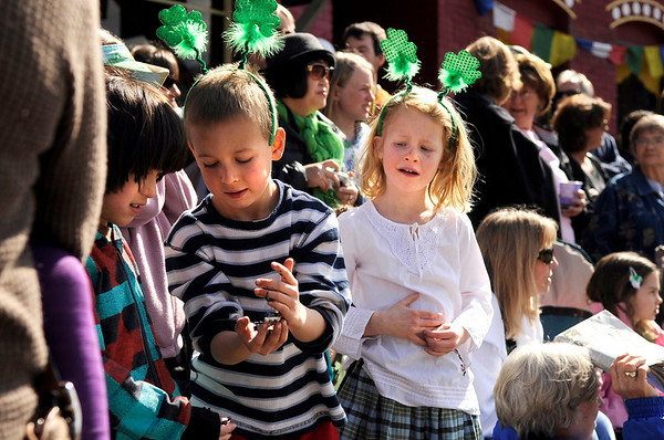 "Jack Lansky, 7, and his twin sister Samantha, right, show off their candy stash to another child during the St. Patricks Day parade on Sunday, March 13, on 13th Street in Boulder. For more photos and video of the parade go to  <a href=""http://www.dailycamera.com"">http://www.dailycamera.com</a><br /> Jeremy Papasso/ Camera"