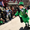 "Grant Niemann, 4, of Lafayette, passes candy out to the crowd while dressed like a Leprechaun during the 2011 St. Patricks Day Parade on 13th Street in Boulder. For more photos and video of the event go to  <a href=""http://www.dailycamera.com"">http://www.dailycamera.com</a><br /> Jeremy Papasso/ Camera"