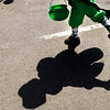 "Grant Niemann, 4, of Lafayette, throws candy to spectators while dressed as a Leprechaun during the St. Patricks Day parade on Sunday, March 13, on 13th Street in Boulder. For more photos and video of the parade go to  <a href=""http://www.dailycamera.com"">http://www.dailycamera.com</a><br /> Jeremy Papasso/ Camera"