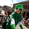 "Jethro Grant, of Boulder, rides his bicycle during the St. Patricks Day parade on Sunday, March 13, on 13th Street in Boulder. For more photos and video of the parade go to  <a href=""http://www.dailycamera.com"">http://www.dailycamera.com</a><br /> Jeremy Papasso/ Camera"
