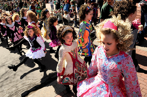 "McTeggart Irish Dancers show their moves on 13th Street during the St. Patricks Day parade on Sunday, March 13, on 13th Street in Boulder. For more photos and video of the parade go to  <a href=""http://www.dailycamera.com"">http://www.dailycamera.com</a><br /> Jeremy Papasso/ Camera"