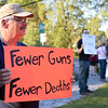 ADAM SHANKS — THE BERKSHIRE EAGLE<br /> Activists stand out against gun violence in Williamstown on Tuesday in response to this week's shooting in Las Vegas, Nev.