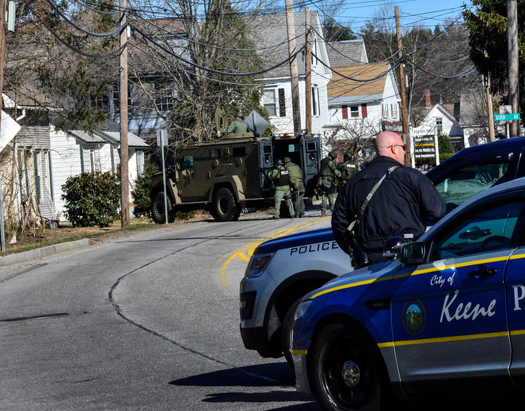KRISTOPHER RADDER - BRATTLEBORO REFORMER<br /> A Bearcat armored vehicle sits in front of a residence of 10 Park Ave., in Keene., N.H., after a man barricaded himself inside.