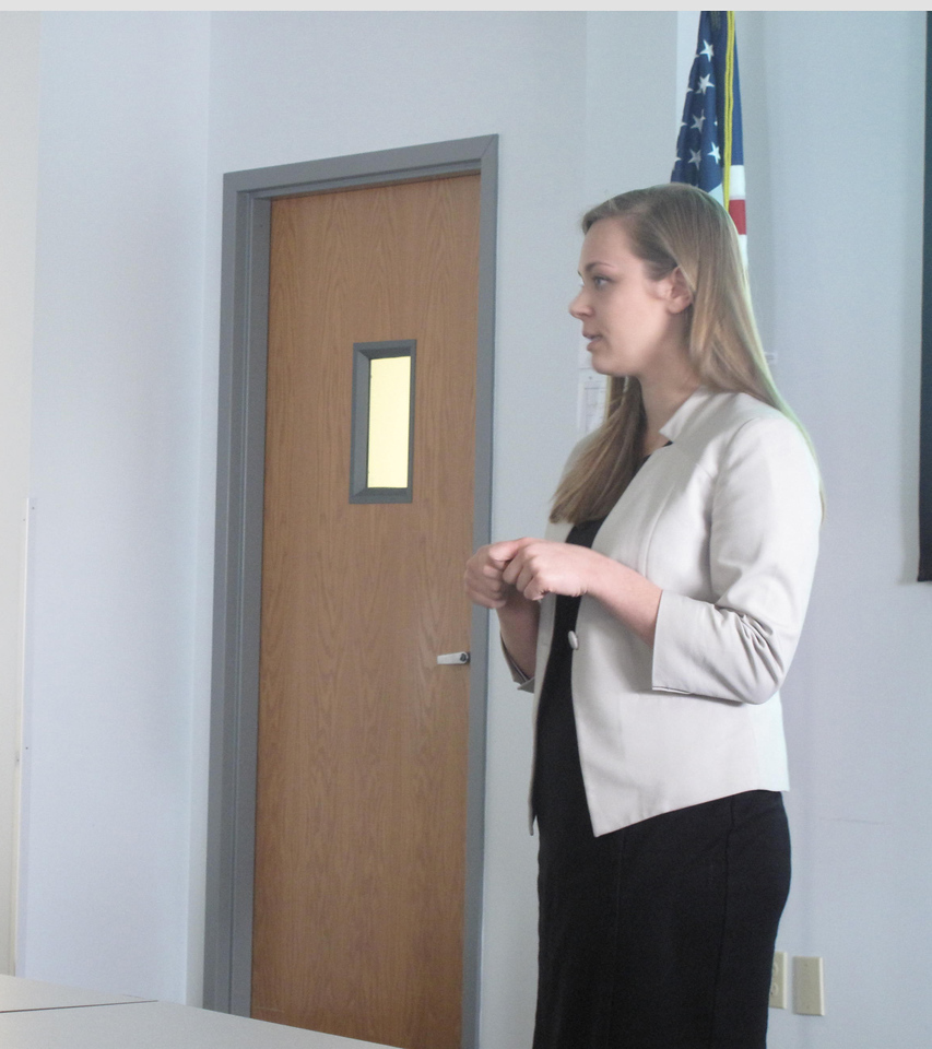 ELIZABETH DOBBINS / GAZETTE Assistant director of Start Talking! Adria Troyer describes drug usage prevention programs to local educators, law enforcement and members of the community.