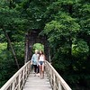BEN GARVER — THE BERKSHIRE EAGLE<br /> Terrie Terrio and Odessa Arce, Members of the Stockbridge-Munsee Mohican Tribal Community wind up their one-week annual visit to their ancestral home with a walk along the Housatonic River, Thursday, July 11, 2019.