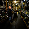 KRISTOPHER RADDER - BRATTLEBORO REFORMER<br /> Mike Barrett, the owner of Stoneholm Farm,  walks through the milking parlor now stands silently. At one time, Barrett pumped milk in the barn for 10 hours a day, 365 days a year.