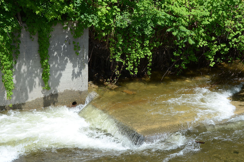 Gillian Jones/North Adams Transcript<br /> <br /> Water cascades over a piece of cement that fell into the Hoosic River from the retaining wall near Willow Dell and Union Street in North Adams.