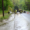 Gillian Jones/North Adams Transcript<br /> Crews work on cleaning up Cold Spring Road in Williamstown on Thursday morning after a strong storm brought heavy rain to the region on Wednesday night.