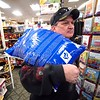 BEN GARVER — THE BERKSHIRE EAGLE<br /> John Acor purchases a bag of snow melt at Carr Hardware in Pittsfield, Saturday, November 30, 2019.