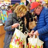 BEN GARVER — THE BERKSHIRE EAGLE<br /> A couple gathers groceries at the Big Y in Pittsfield for the coming winter storm, Saturday, November 30, 2019.