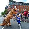 KRISTOPHER RADDER - BRATTLEBORO REFORMER<br /> Jack Branley, 4, of Brattleboro, high-fives a T-Rex during the annual Strolling of the Heifers Parade in Brattleboro on Saturday, June 2, 2018.