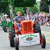 KRISTOPHER RADDER - BRATTLEBORO REFORMER<br /> Bill French, of the Cast and Brass Antique Machinery Club, leads the tractors down Main Street during the annual Strolling of the Heifers Parade, in Brattleboro, on Saturday, June 2, 2018.
